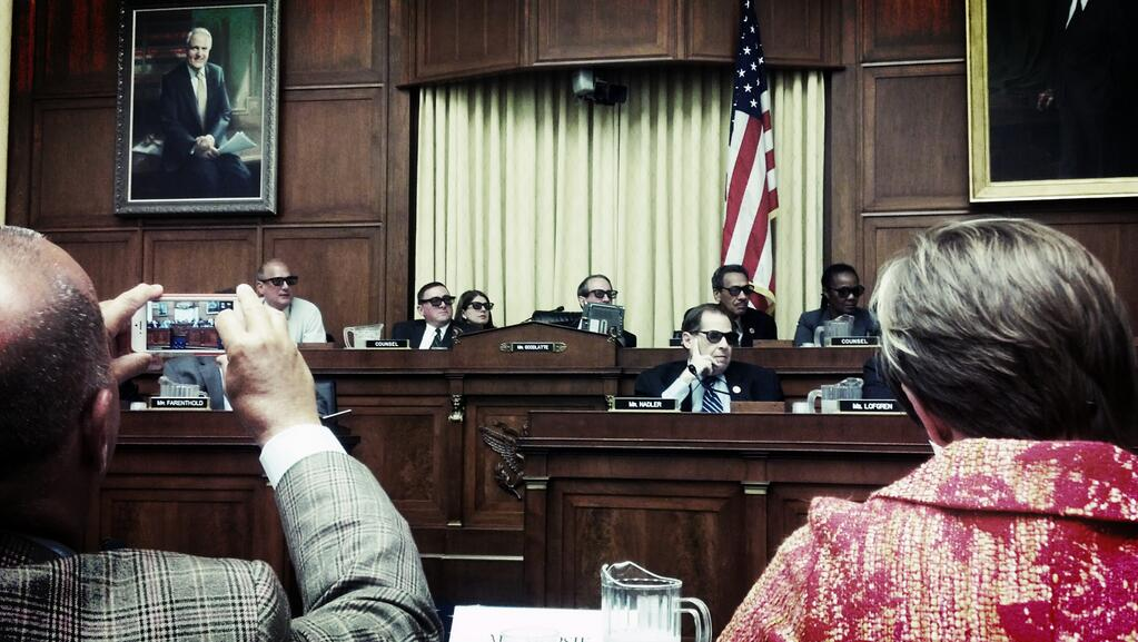 Representatives wear 3D glasses during Congressional hearing